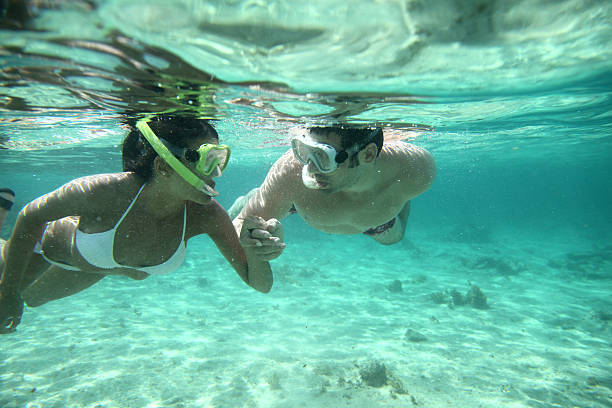 Underwater photo of couple snorkeling stock photo