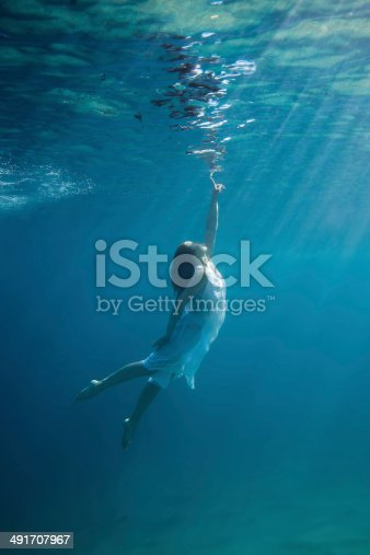 Young redhead woman underwater