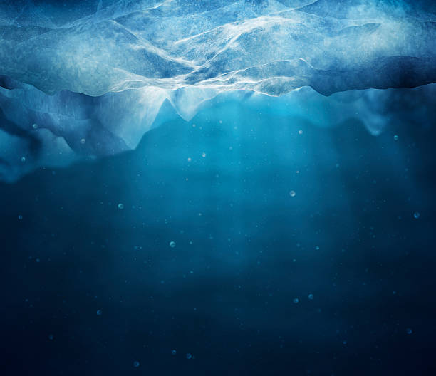 underwater picture of sunbeams through layer of ice - iceberg stock photos and pictures