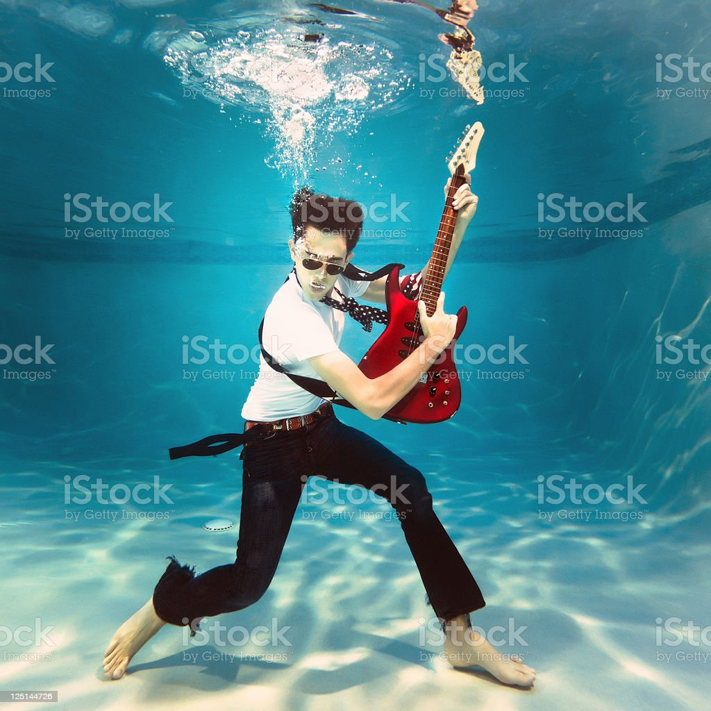 underwater rock and roll stock photo