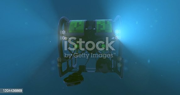 A deep sea ROV - remote operated vehicle, with it's lights penetrating the darkness of the bottom of the ocean