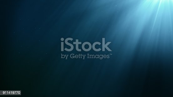 istock Underwater scene with air bubbles floating up and sun shining through the water 3d illustration 911419770
