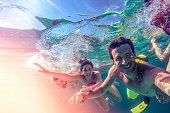 Photo of friends taking an underwater selfie