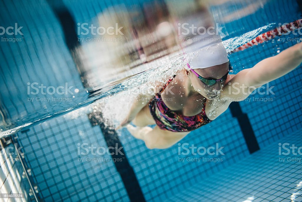 Underwater shot of a female swimmer stock photo