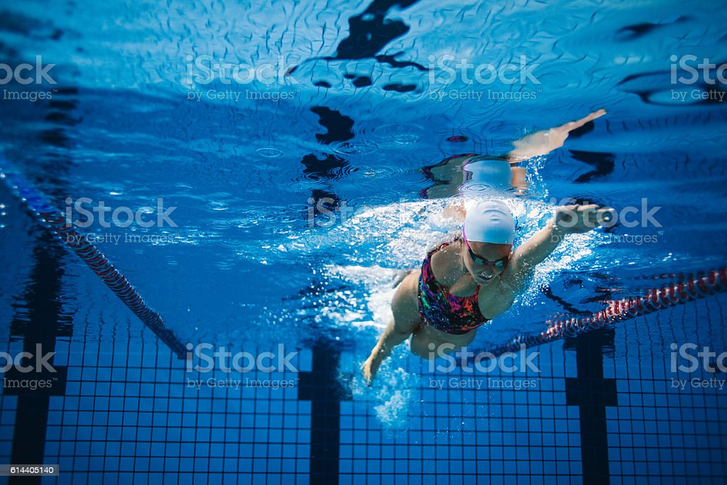 Underwater shot of female swimmer in action stock photo