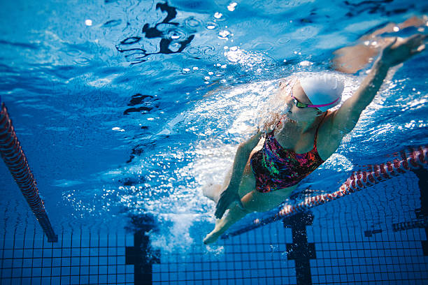 underwater shot of swimmer training in the pool - 水泳 ストックフォトと画像