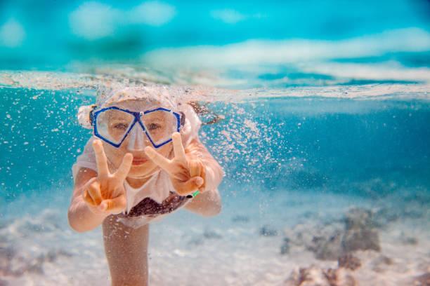 Underwater Snorkeling Adventure For Little Girl stock photo