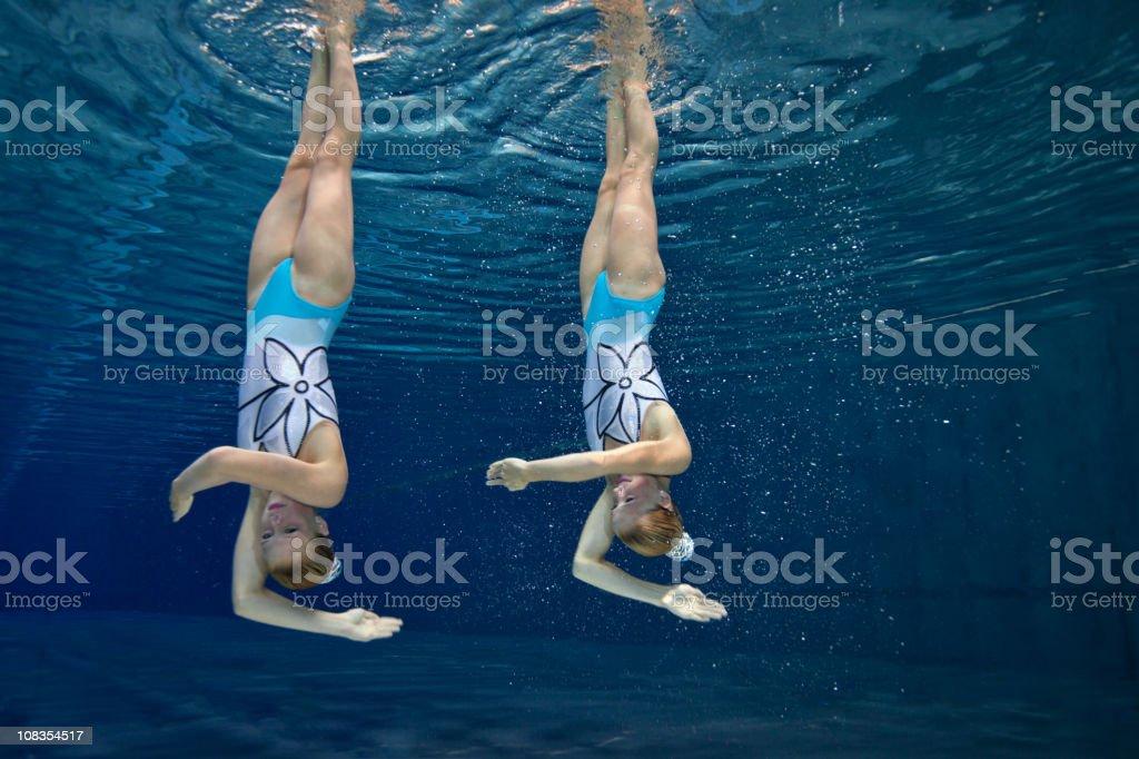 underwater synchronized swimming figure stock photo