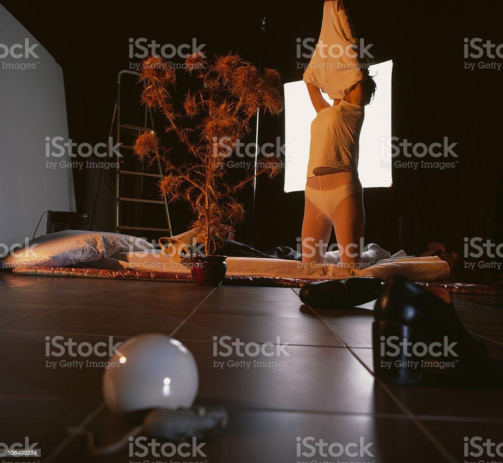 Undressing Woman, phase 3 stock photo