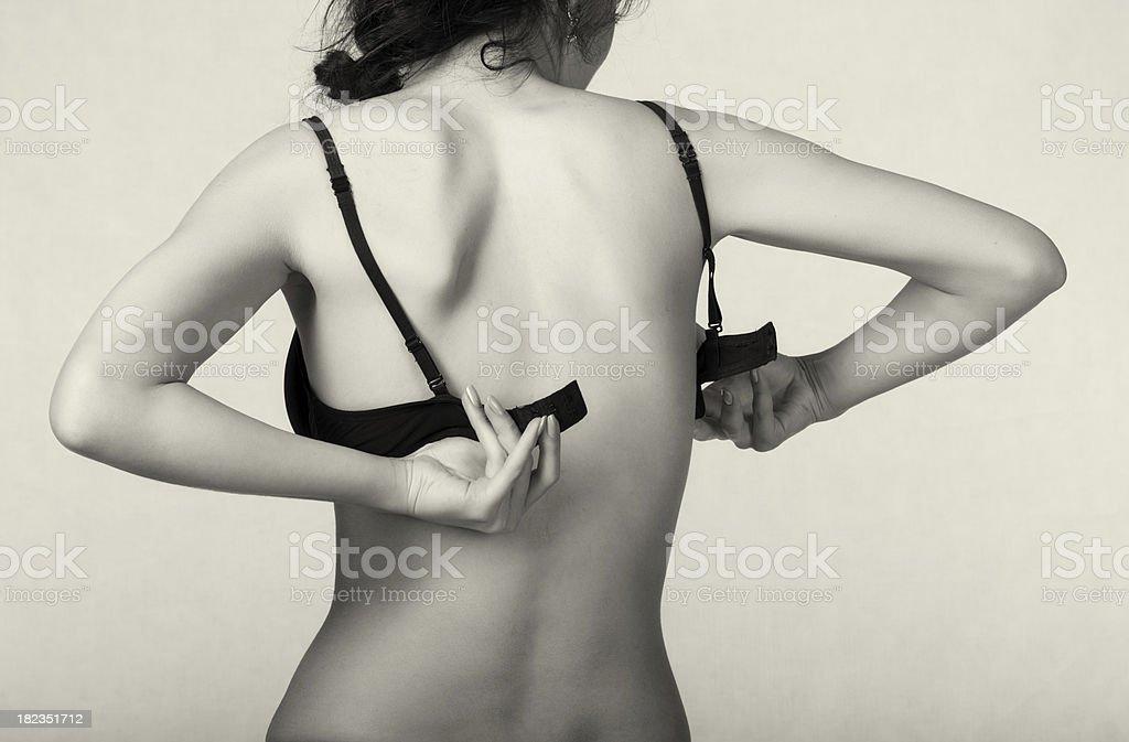Undressing woman stock photo