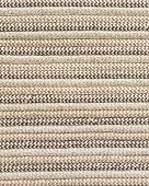 Undyed wool rug texture in neutral tones