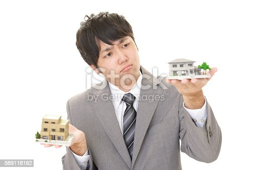 istock Uneasy Asian Businessman 589118162