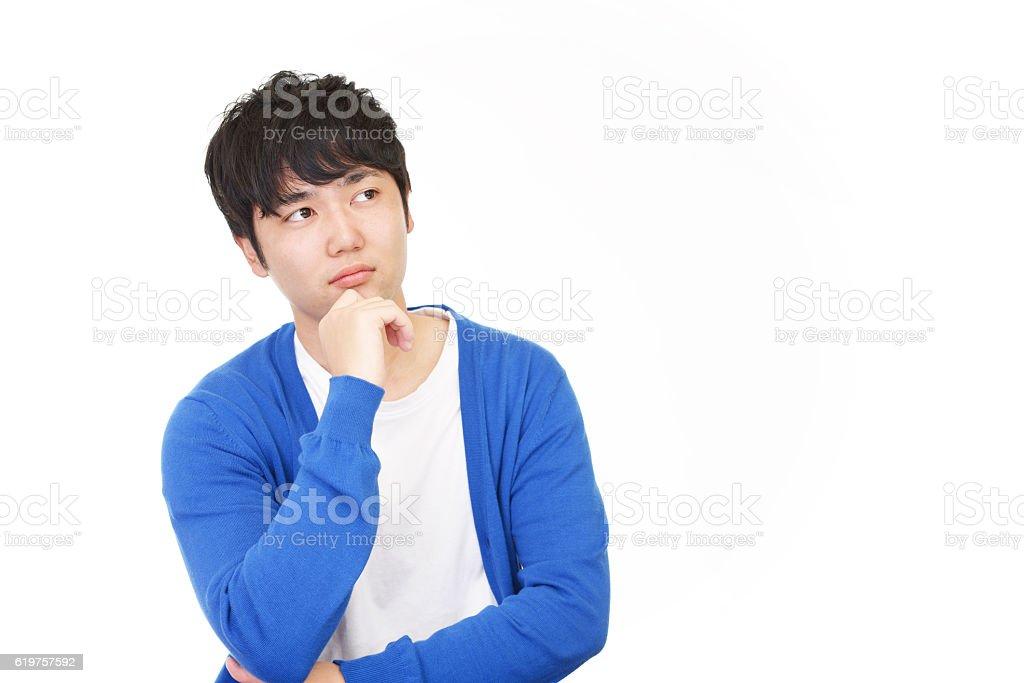 Uneasy Asian Businessman stock photo