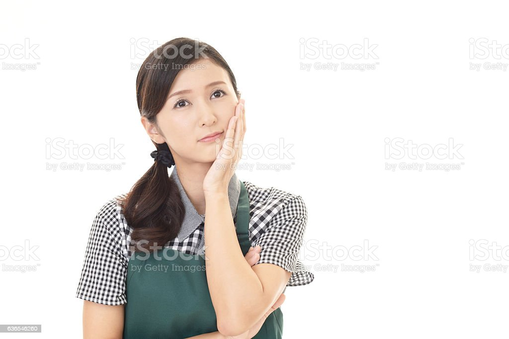 Uneasy Asian woman stock photo
