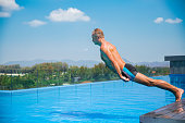 Unemotional funny man falling into swimming pool. Summer vacation