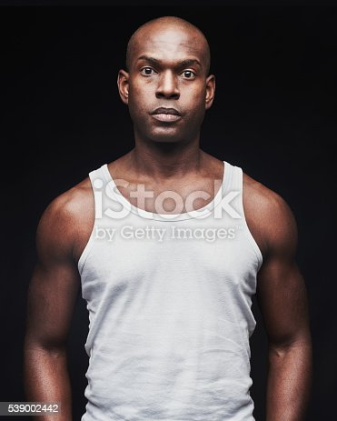 istock Unemotional young black man in tank top 539002442