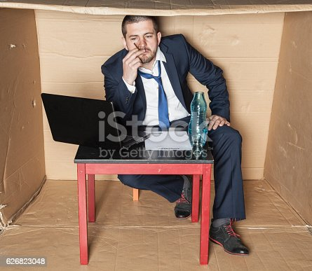 istock Unemployed businessman smokes and drinks alcohol 626823048