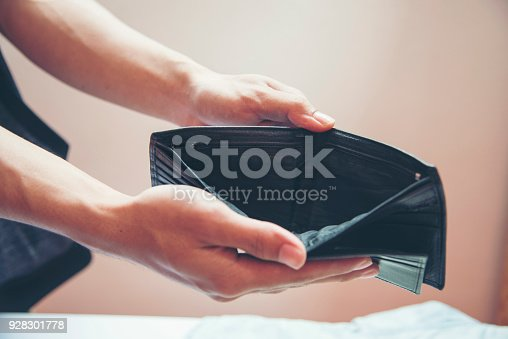 istock Unemployed man showing empty wallet. Close up hands of poor man open empty purse. bankrupt background poor homeless. 928301778