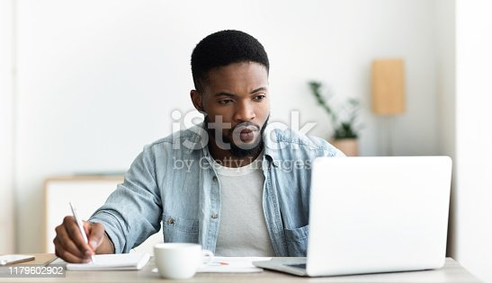 istock Unemployed man using laptop searching for vacancies online in internet 1179602902