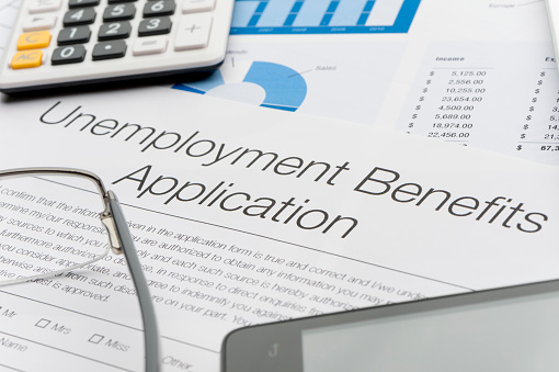 Unemployment Benefits Application Form With Paperwork Stock Photo - Download Image Now