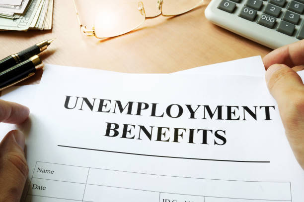 unemployment benefits form on a table. - unemployment stock pictures, royalty-free photos & images