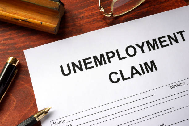 unemployment claim form on an office table. - unemployment stock pictures, royalty-free photos & images