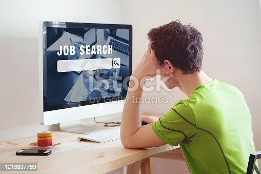 unemployment concept, job search on internet, man at home looking for good career