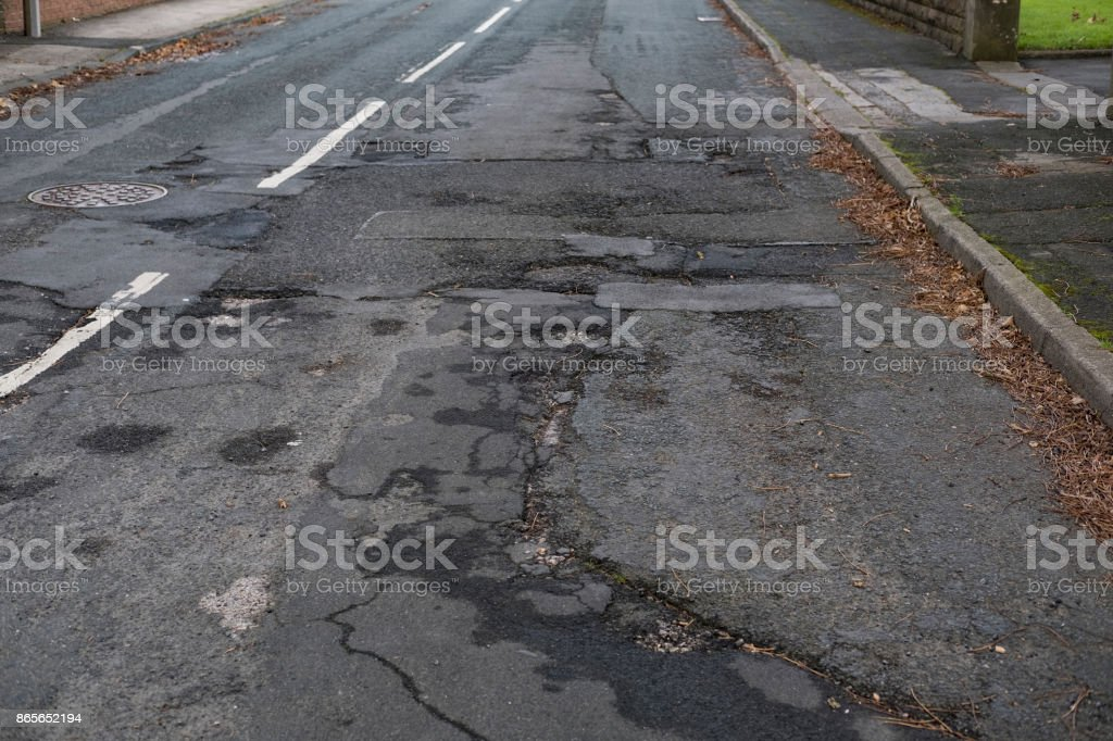 Uneven cracked British Road in the Northwest of England. stock photo