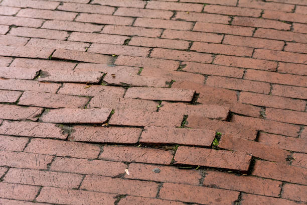 uneven pavement of red bricks - uneven stock photos and pictures