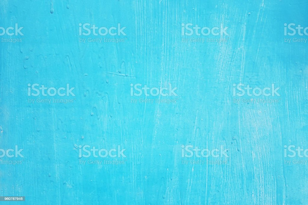 unevenly painted surface of blue color with cracks stock photo