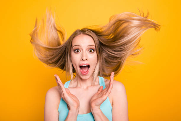 unexpectedly good news! black friday this week! close up portrait of young blonde girl joyfully shouts wide open eyes and mouth isolated on vivid yellow background with copy space for text - smile woman open mouth foto e immagini stock