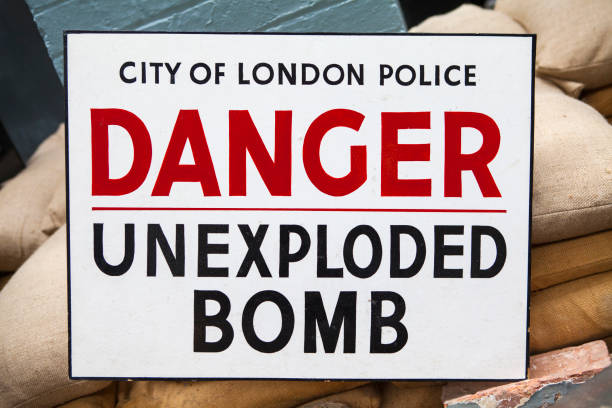 Unexploded Bomb Sign An Unexploded Bomb Sign - similar to what would have been seen during the Second World War in the UK. war effort stock pictures, royalty-free photos & images