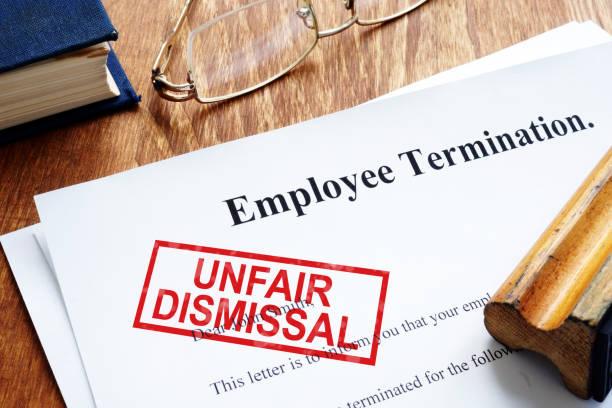 Unfair dismissal stamp on the Employee Termination. stock photo