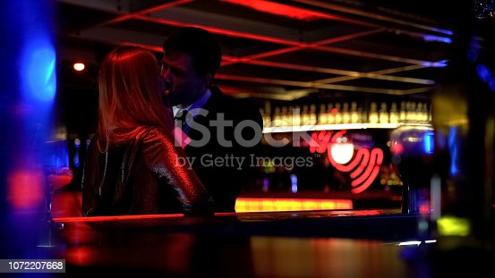istock Unfaithful husband meeting secretly lover woman in nightclub, lie, betrayal 1072207668