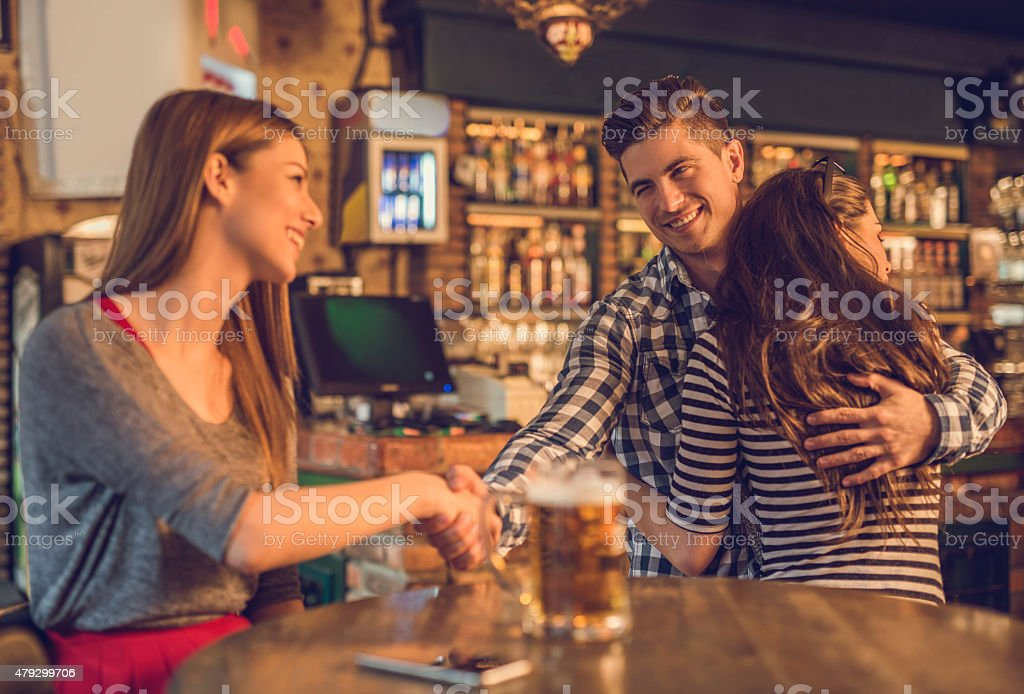 Unfaithful young man in a cafe. stock photo