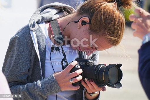 Samara, Russia - August 18, 2018: Unfamiliar girl with a camera