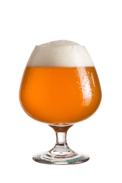 Unfiltered beer Glass of cold unfiltered wheat beer isolated on white background ale stock pictures, royalty-free photos & images