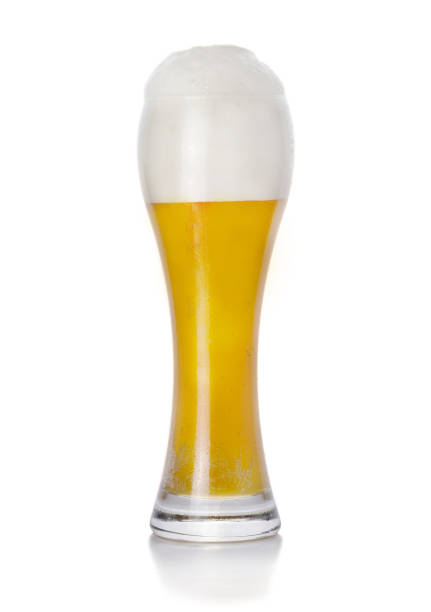 Unfiltered wheaten fresh beer Wheat foam fresh beer light beer on white background apostate stock pictures, royalty-free photos & images