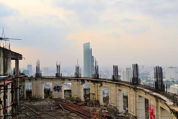 Unfinished abandoned skyscraper Sathorn Unique stock photo