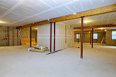 istock Unfinished basement framing construction project 1255107962