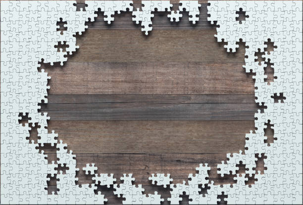 Unfinished Blank Jigsaw Puzzle Blank jigsaw puzzle missing half to finish. Concept of work not completed. jigsaw piece stock pictures, royalty-free photos & images