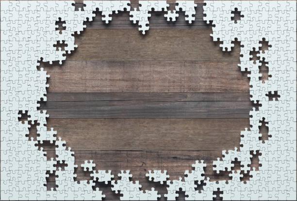 unvollendete leer jigsaw puzzle - puzzleteile stock-fotos und bilder