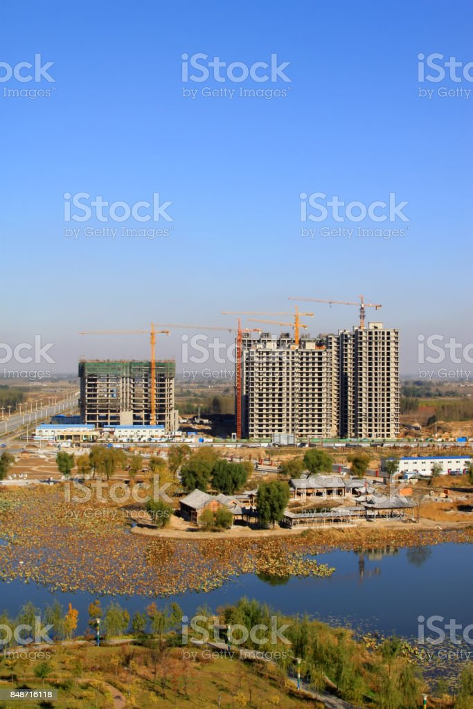 unfinished building by the water in China stock photo