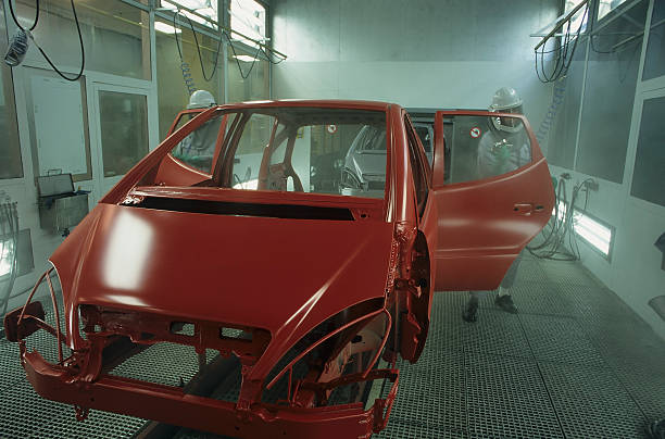 Unfinished frame of red car in auto shop stock photo