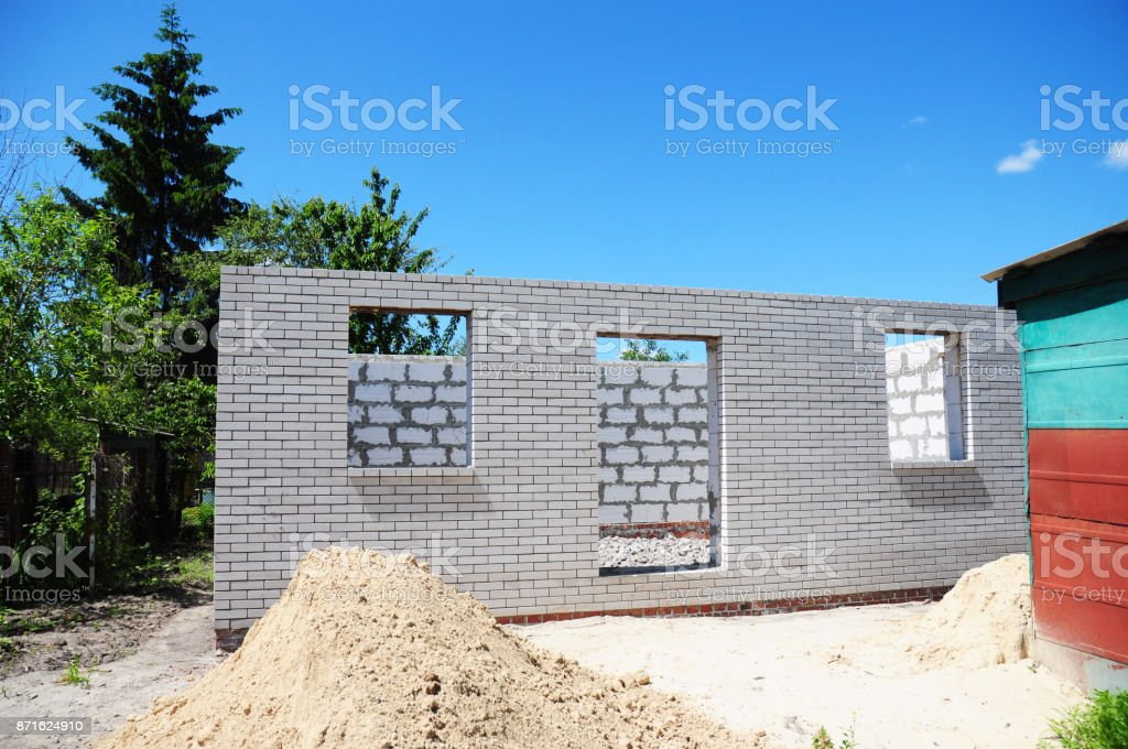 Unfinished House  from Autoclaved Aerated Concrete Blocks and White Bricks. stock photo