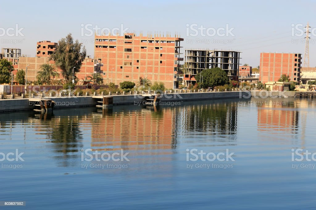 Unfinished houses along the banks of the Nile River in Esna, Egypt stock photo