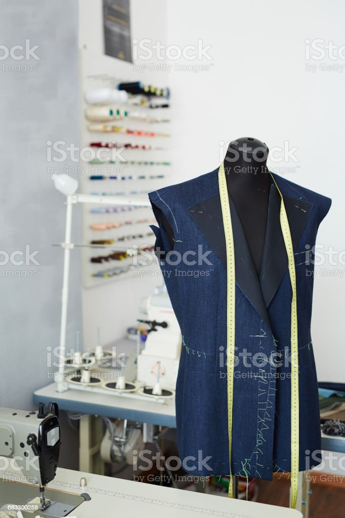 Unfinished Jacket on mannequin in Tailoring Studio stock photo