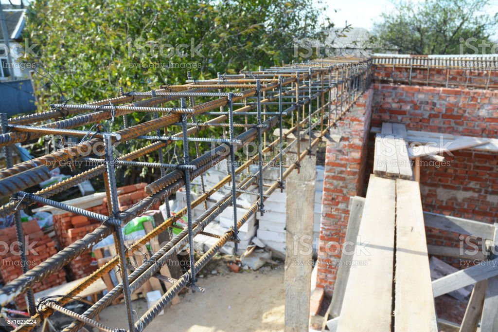 Unfinished Red Brick House Wall Under Construction without Roofing. Lintel Construction. stock photo