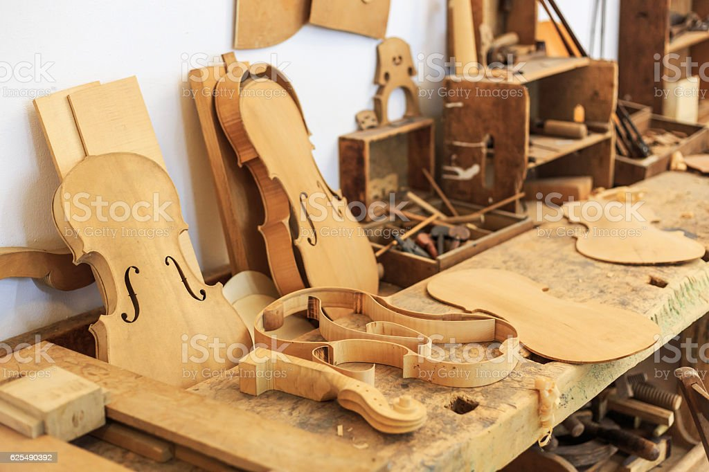 Unfinished viola and wooden tools in workshop stock photo