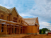 istock Unfinished wood frame building or framing beam of new house 1143736771